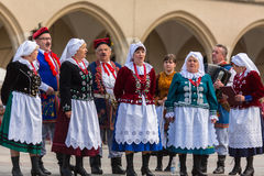 Polish folk collective on Main square during annual Polish national and public holiday the Constitution Day Royalty Free Stock Photo