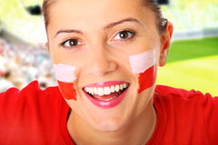 Polish football fan. A picture of a happy Polish female fan cheering over stadium background Royalty Free Stock Photos