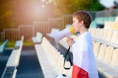 Polish football fan - little boy with megaphone Royalty Free Stock Images