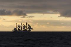 Polish fullrigger Dar Mlodziezy under sail at dawn Royalty Free Stock Image