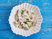 Polish Herring in Sour Cream. Sledzie  smietanie, close up Royalty Free Stock Photos