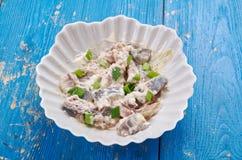 Polish Herring in Sour Cream. Sledzie  smietanie, close up Stock Photography