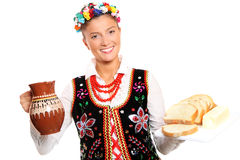 Polish hospitality. A portrait of a beautiful and hospitable Polish woman in a traditional outfit Royalty Free Stock Images