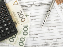 Polish individual income tax. Filling in polish individual income tax form PIT with money and pen Stock Images