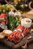 Polish kabanos dried sausage. Served on wooden board Stock Photography