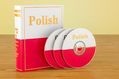 Polish language textbook with flag of Poland and CD discs on the. Wooden table. 3D Royalty Free Stock Photography