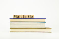 Polish language word on wood stamps and books Royalty Free Stock Images