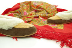 Polish leather home slippers and folklore shawl Stock Image