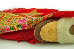 Polish leather home slippers and folklore shawl Stock Photos