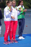 Polish Magdalena Fularczyk-Kozlowska and Natalia Madaj with Olympic gold medals Stock Photography