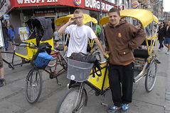 POLISH MALE PEDICAB DRIVERS Royalty Free Stock Images