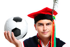 Polish man in a traditional outfit with football Stock Photo