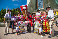Peruvian and Polish traditional dress Royalty Free Stock Image