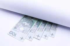 Polish money, banknotes under roll of paper Royalty Free Stock Photos