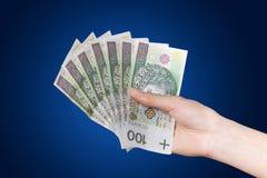 Polish Money. Blue background. Stock Photo