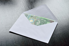 Polish money in envelope – bribe. Royalty Free Stock Images