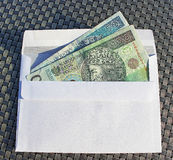Polish money in envelope – bribe. Royalty Free Stock Photo