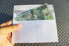Polish money in envelope – bribe. Royalty Free Stock Images
