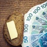 Polish money on kitchen table, coast of living Stock Photos