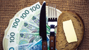 Polish money on kitchen table, coast of living Royalty Free Stock Photography