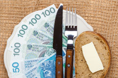Polish money on kitchen table, coast of living Royalty Free Stock Image