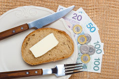 Polish money on kitchen table, coast of living Stock Photo