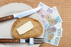 Polish money on kitchen table, coast of living Stock Photos