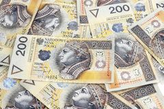 Polish money. Lie scattered on the table Stock Photos