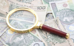 Polish money with magnifying glass Stock Photography