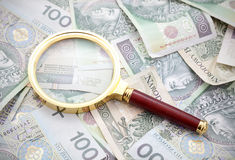 Polish money with magnifying glass Stock Image