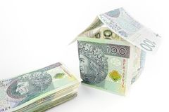 Polish money. Stacked in the house on a white background Royalty Free Stock Photo