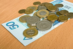 Polish money - zloty, banknotes and coins. On the table Stock Images