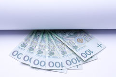 Polish money zloty, banknotes under roll of paper Stock Image