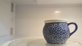 Polish Mug in Microwave Stock Photo