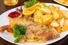 Polish national dish - duck with apples and potato Stock Photos