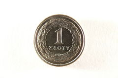 Polish one coin. Macro photo of one polish zloty over white Royalty Free Stock Image