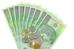 Polish one hundred zloty banknotes and coins Royalty Free Stock Image