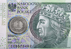 Polish one hundred zloty bill and coin macro Stock Image