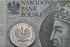 Polish one hundred zloty bill and coin macro Stock Photography
