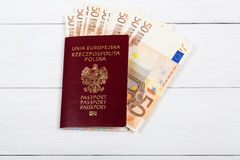 Polish passport with the European currency Royalty Free Stock Images