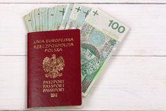 Polish passport with Polish currency Royalty Free Stock Images