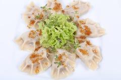 Polish pierogi. Boiled pierogi (Polish dumplings) stuffed with meat and spinach Stock Photography