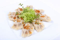 Polish pierogi, dumplings. Boiled pierogi (Polish dumplings) stuffed with meat and spinach royalty free stock photos