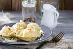 Polish pierogi with potatoes and onion Stock Photography