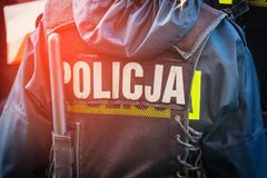 Polish police officer, back view. Close up Stock Photography