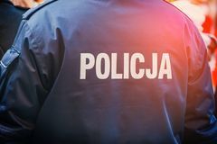 Polish police officer, back view. Close up Royalty Free Stock Photography