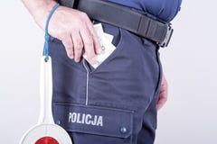 Polish policeman corrupt Royalty Free Stock Image