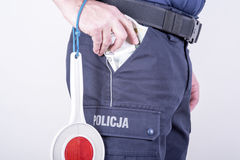 Polish policeman corrupt Royalty Free Stock Photography