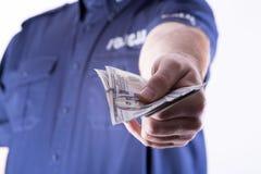 Polish policeman corrupt Stock Images