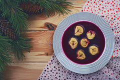 Polish red borscht with dumplings Stock Images